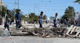 Unemployed newly-graduated Tunisian youths walk past a makeshift road block in the locality of Laataya on the island of Kerkennah on April 15, 2016 after residents blocked a road to prevent the police and trucks from using it following clashes between Tunisian security forces and residents over social protests related to Tunisia's natural gas facility of UK based oil company Petrofac.  Petrofac facility on Kerkennah island has halted production since social protests started in January 2016.  / AFP / FETHI BELAID        (Photo credit should read FETHI BELAID/AFP/Getty Images)