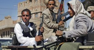 Houthi rebels ride in a military truck in Sanaa. Hani Mohammed / AP